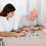 Two Women Playing Jigsaw Puzzle